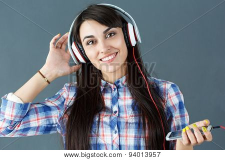 Beautiful Dark Haired Smiling Woman Wearing Headphones