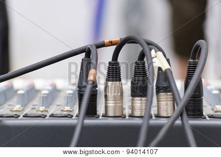 Microphone Xrl Connectors Pluged In A Audio Mixing Console