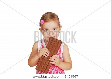 little girl eat large chocolate