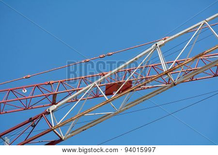 Crane Arms Diagonally Against The Blue Sky
