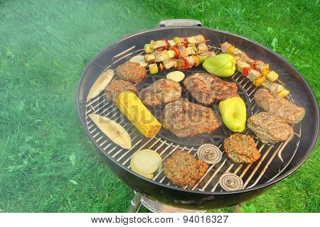 Bbq Grill With Steaks, Kebabs And Vegetables Top View