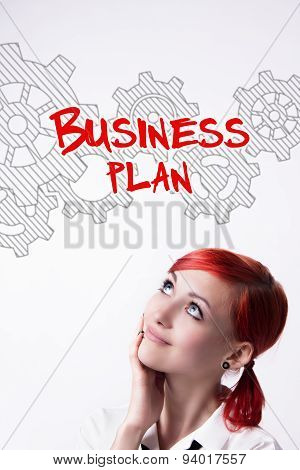 Red-haired Girl Is Developing A Business Plan