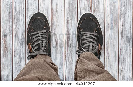 Gray Sneakers On White Wooden Background.