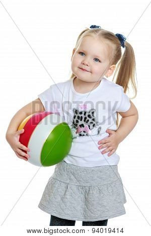 Beautiful chubby little girl with a ball in his hand , close-up