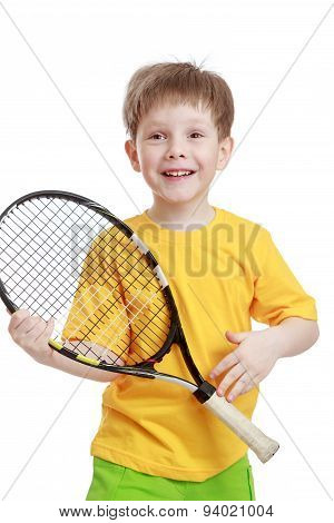 Little boy holding a tennis racket, close-up