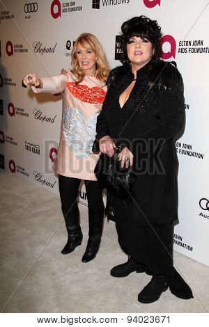 LOS ANGELES - MAR 3:  Ann Wilson, Nancy Wilson at the Elton John AIDS Foundation's Oscar Viewing Party at the West Hollywood Park on March 3, 2014 in West Hollywood, CA