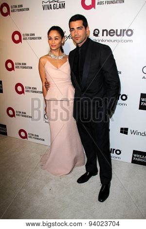 LOS ANGELES - MAR 3:  Jesse Metcalfe, Cara Santana at the Elton John AIDS Foundation's Oscar Viewing Party at the West Hollywood Park on March 3, 2014 in West Hollywood, CA