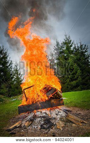 Burning Furniture On A Big Bonfire