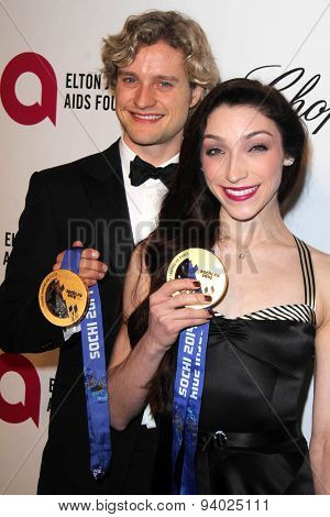 LOS ANGELES - MAR 3:  Charlie White, Meryl Davis at the Elton John AIDS Foundation's Oscar Viewing Party at the West Hollywood Park on March 3, 2014 in West Hollywood, CA