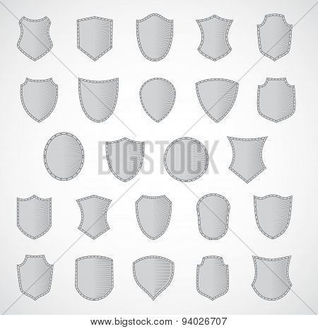 Silver shield design set with various shapes. Style engraving