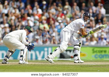 MANCHESTER, ENGLAND - August 03 2013: Brad Haddin and Kevin Pietersen during day three of  the Investec Ashes 3rd test match at Old Trafford Cricket Ground, on August 03, 2013 in London, England.
