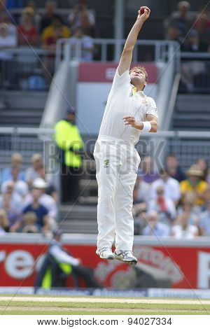 MANCHESTER, ENGLAND - August 04 2013: Ryan Harris catches the ball during day four of  the Investec Ashes 4th test match at Old Trafford Cricket Ground, on August 04, 2013 in London, England.