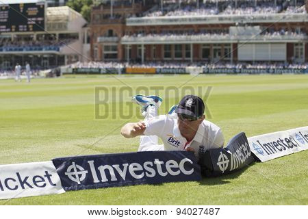 LONDON, ENGLAND - July 19 2013: Jonny Bairstow saves four runs during day two of the Investec Ashes 2nd test match, at Lords Cricket Ground on July 19, 2013 in London, England.