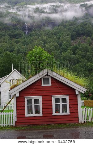 Little Red House With Grass Roof