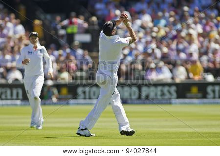 iLONDON, ENGLAND - July 19 2013: Phillip Hughes hits the ball in the air and is caught out by Kevin Pietersen during day two of the  Ashes 2nd test match, at Lords Cricket Ground on July 19, 2013