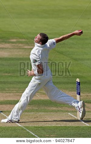 LONDON, ENGLAND - July 18 2013: Peter Siddle bowling on day one of the Investec Ashes 2nd test match, at Lords Cricket Ground on July 18, 2013 in London, England.