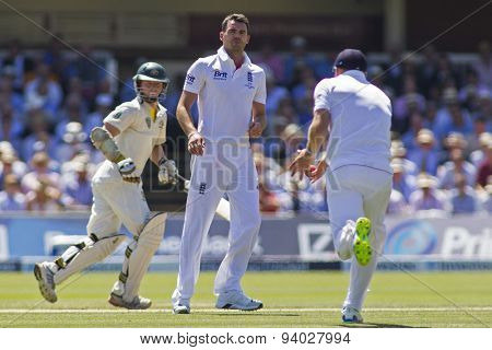 LONDON, ENGLAND - July 19 2013: Chris Rogers and James Anderson watch on as Jonny Bairstow fields the ball during day two of the Investec Ashes 2nd test match, at Lords Cricket Ground on July 19, 2013