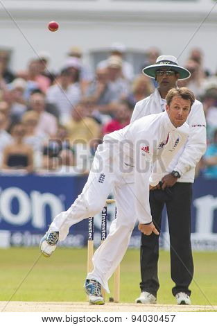 NOTTINGHAM, ENGLAND - July 14, 2013: Graeme Swann bowling during day five of the first Investec Ashes Test match at Trent Bridge Cricket Ground on July 14, 2013 in Nottingham, England.