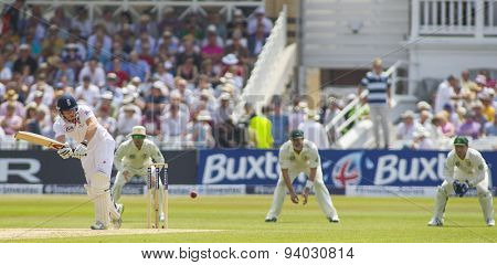 NOTTINGHAM, ENGLAND - July 12, 2013: England's Jonny Bairstow hits the ball as Michael Clarke, Shane Watson, and Brad Haddin watch on during the Ashes Test match at Trent Bridge Cricket Ground