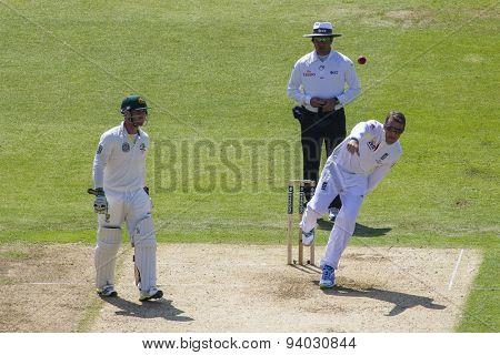 NOTTINGHAM, ENGLAND - July 11, 2013: Phillip Hughes watches on as Graeme Swann bowls the ball during day two of the first Investec Ashes Test match at Trent Bridge Cricket Ground