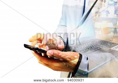Double Exposure Of Business Man Using Mobile Phone With Notebook Or Laptop Computer