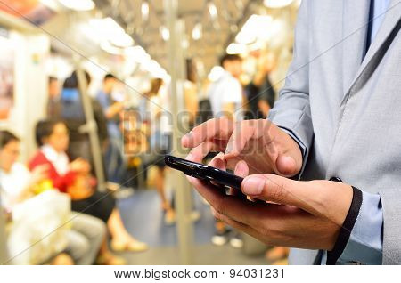 Business Man Using Mobile Phone In Train