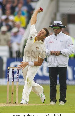 NOTTINGHAM, ENGLAND - July 10, 2013: Australia's James Pattinson and umpire Aleem Dar during day one of the first Investec Ashes Test match at Trent Bridge Cricket Ground on July 10, 2013