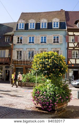 A View In Colmar City With A Flower Composition. Alsace, France