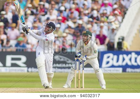 NOTTINGHAM, ENGLAND - July 12, 2013: Stuart Broad hits the ball as Brad Haddin looks on during day three of the first Investec Ashes Test match at Trent Bridge Cricket Ground on July 12, 2013