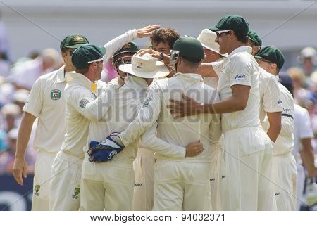 NOTTINGHAM, ENGLAND - July 12, 2013: Australia celebrates the wicket of Alastair Cook from the bowling of Ashton Agar during day three of the first Ashes Test match at Trent Bridge Cricket Ground
