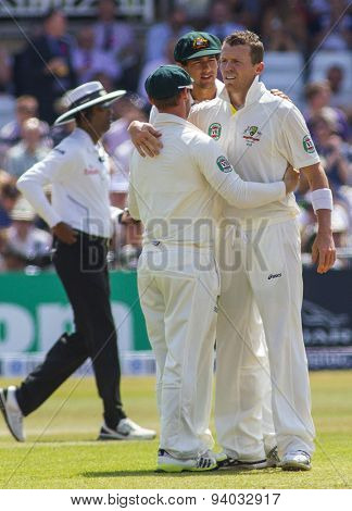 NOTTINGHAM, ENGLAND - July 13, 2013: Peter Siddle gets congratulated by his team mates after taking a wicket during day four of the first Investec Ashes Test match at Trent Bridge Cricket Ground.