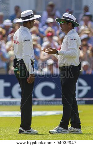 NOTTINGHAM, ENGLAND - July 13, 2013: umpires Kumar Dharmasena, and Aleem Dar have a discussion during day four of the first Investec Ashes Test match at Trent Bridge Cricket Ground