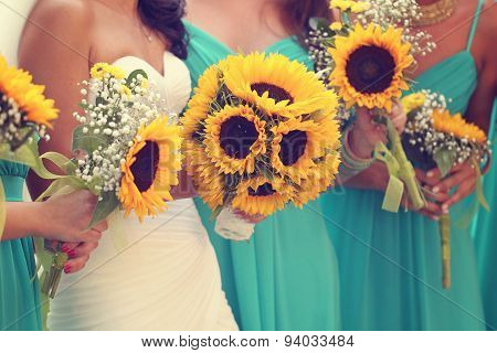 Bride And Bridesmaids With Sunflowers Bouquet