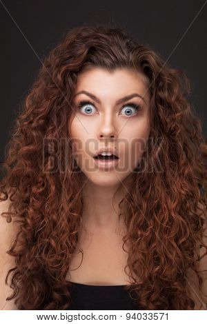 woman with healthy brown curly hair
