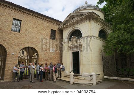 Tourists stand in front of the Dain Ravenna, Italy.nte's Tomb in Ravenna, Italy.
