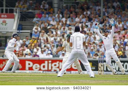 MANCHESTER, ENGLAND - August 01 2013: Matt Prior catches the ball to dismiss Usman Khawaja off the bowling of Graeme Swann (not pictured) during day one of  the Investec Ashes 3rd test match