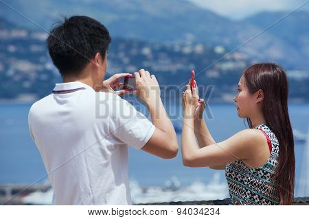 Asian couple make photos at the viewpoint in Monaco.