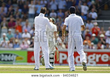 MANCHESTER, ENGLAND - August 02 2013: Graeme Swann sarcastically claps Steven Smith after dismissing him during day one of  the Investec Ashes 3rd test match at Old Trafford Cricket Ground
