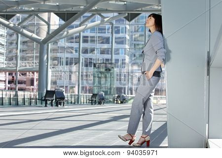 Business Woman Standing Inside City Building