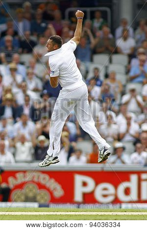 MANCHESTER, ENGLAND - August 01 2013: Tim Bresnan celebrates taking the wicket of Shane Watson during day one of  the Investec Ashes 3rd test match at Old Trafford Cricket Ground, on August 01, 2013