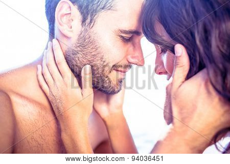 Happy cute couple hugging together at the beach