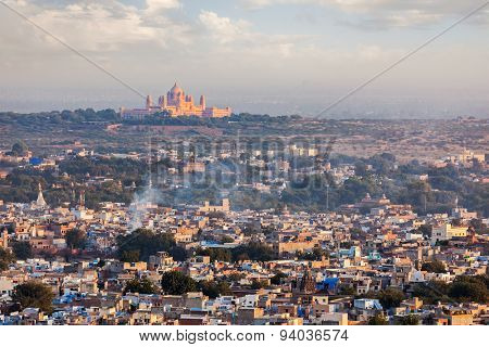 Aerial view of Jodhpur - the Blue city - with Umaid Bhawan Palace on sunset. View from Mehrangarh Fort.  Jodphur, Rajasthan, India