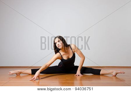 Beautiful Ballet Dancer Performing Split On The Floor