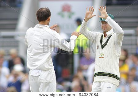 MANCHESTER, ENGLAND - August 04 2013: Nathan Lyon and Michael Clarke celebrates the wicket of Stuart Broad during day four of the Ashes 4th test match at Old Trafford Cricket Ground, on August 04 2013