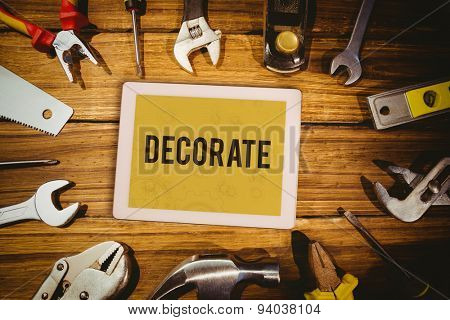 The word decorate and tablet pc against architect background