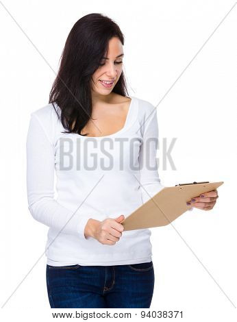 Brunette woman looking at the file pad
