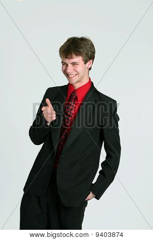 Teen Boy In Suit Pointing