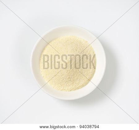 soup plate of grits on white background