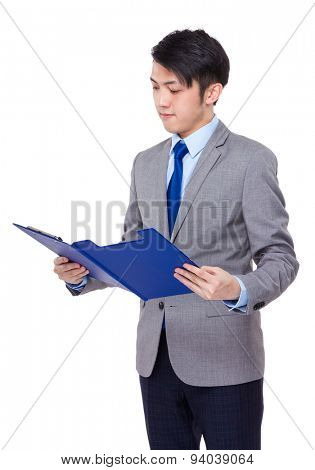 Confident businessman read on the report