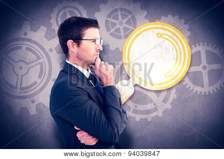 Frowning businessman thinking against white and grey background